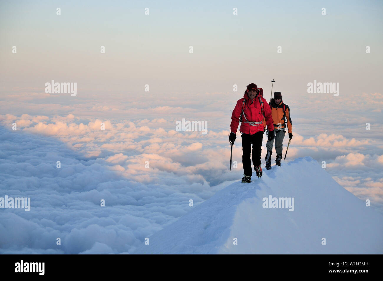 Mountaineers crossing the Aiguille de Bionnassay, Mont Blanc, France - Stock Image