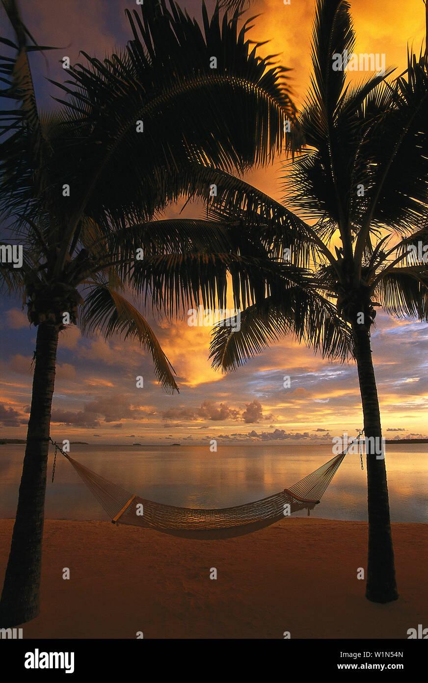 Hammock At Sunset Aitutaki Lagoon Resort Cook Islands Stock