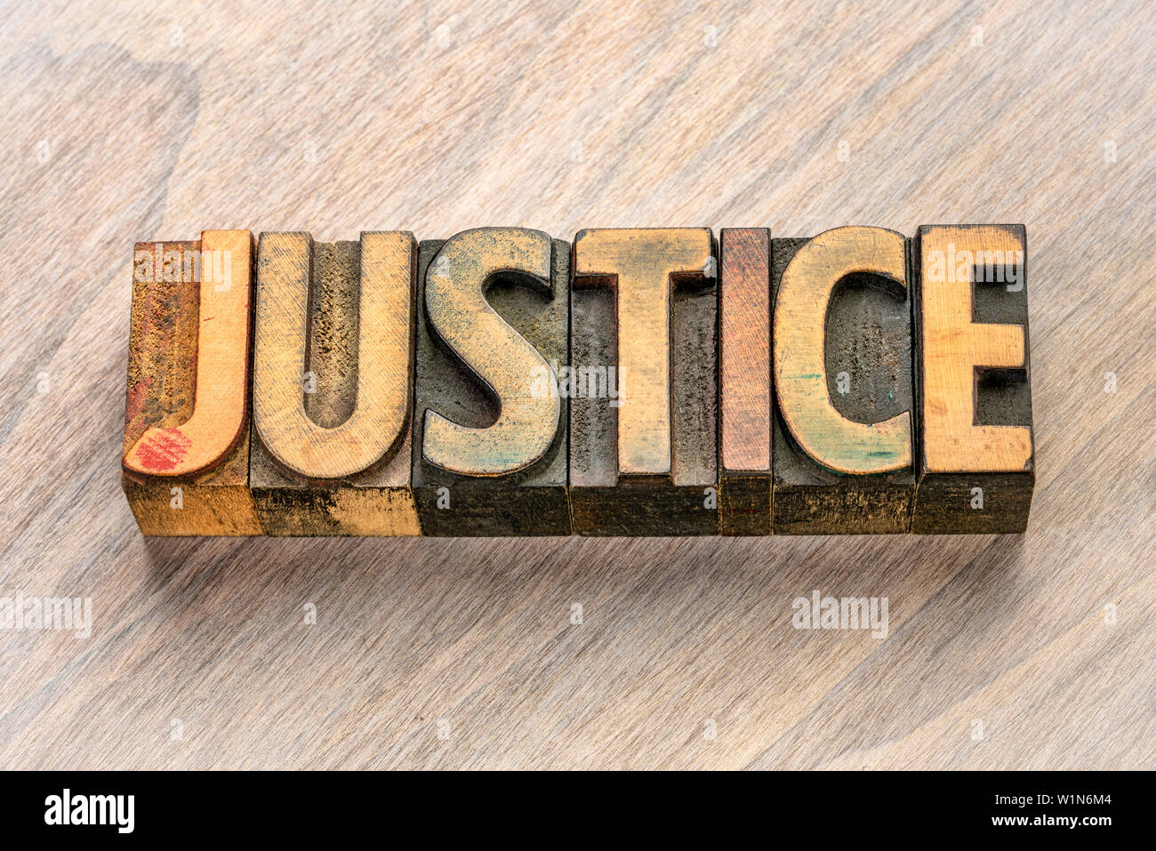 justice word abstract in vintage letterpress wood type printing blocks - Stock Image