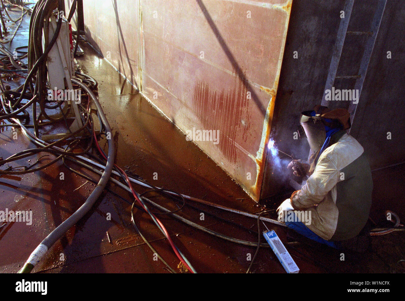 Welding steel-plates, dry dock, Queen Mary 2, Saint-Nazaire, France - Stock Image