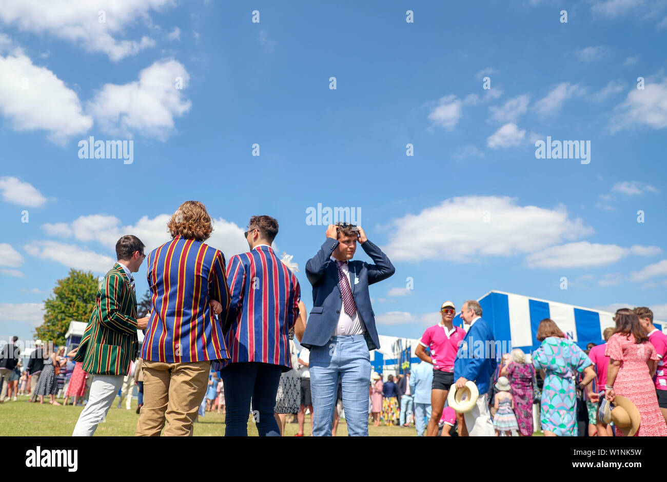 Spectators on the opening day of the 2019 Henley Royal Regatta alongside the river Thames. - Stock Image