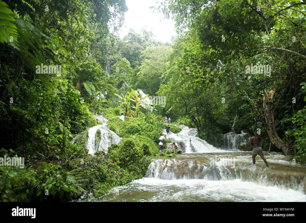 The tumbling waters of the Mele Cascades on the island of Efate - Stock Image