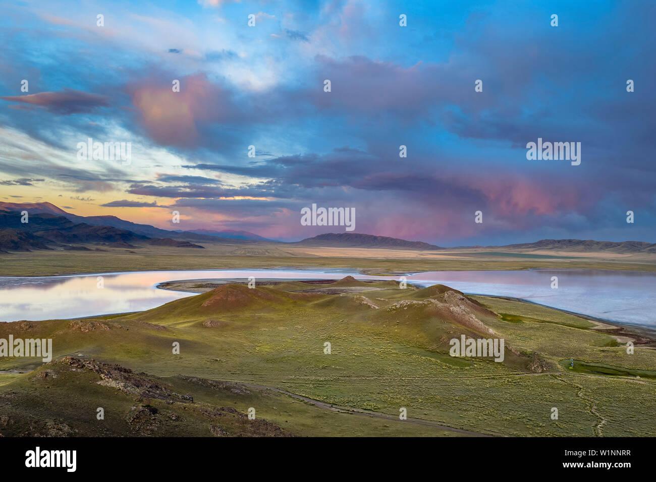 Sunset over steppe and mountain landscape, Tuzkoel Salt Lake, Tuzkol, Tien Shan, Tian Shan, Almaty region, Kazakhstan, Central Asia, Asia Stock Photo