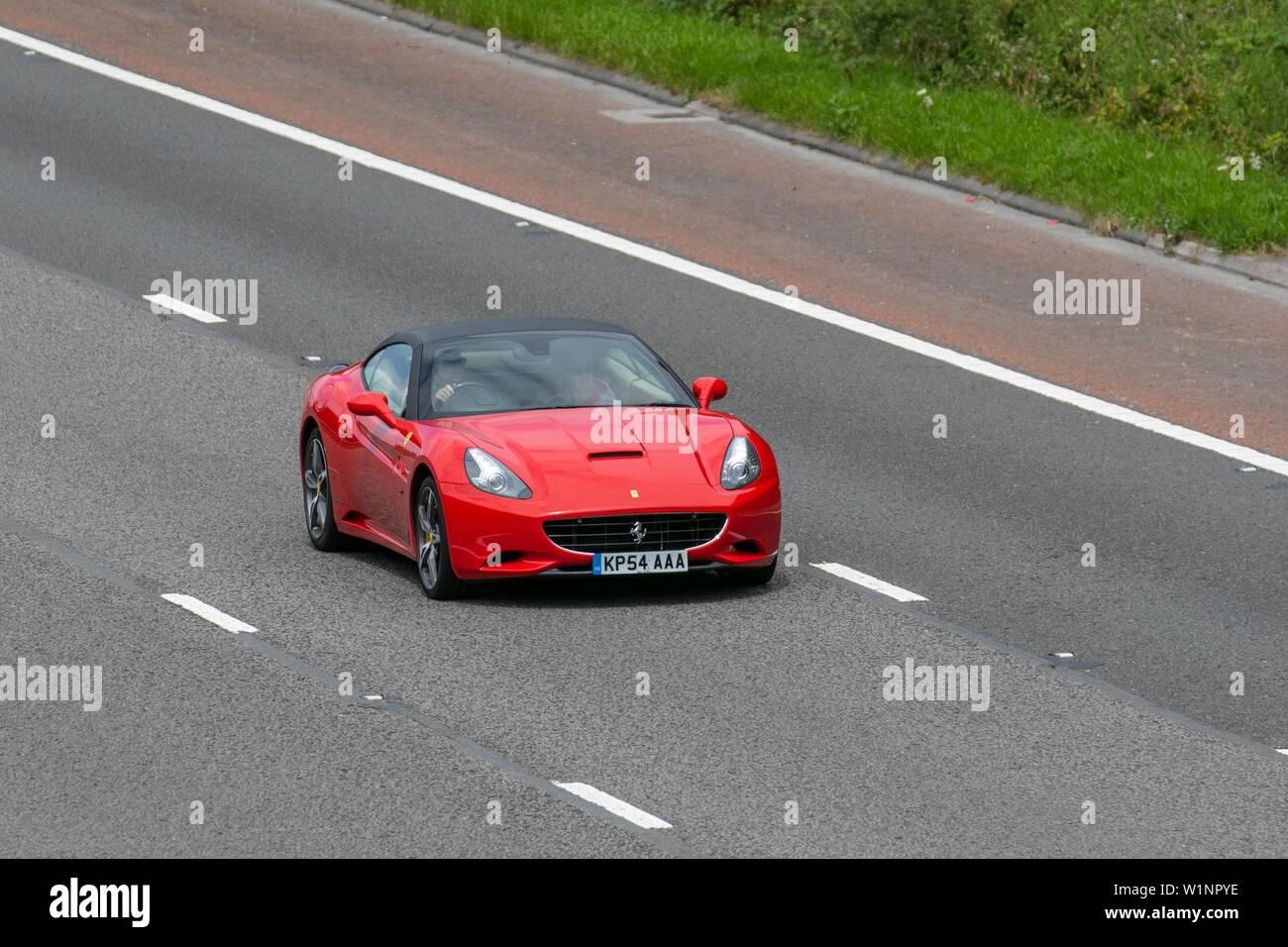 2014 Ferrari California 2 Plus 2 S-A; UK Vehicular traffic, transport, modern, saloon cars, north-bound on the 3 lane highway. - Stock Image