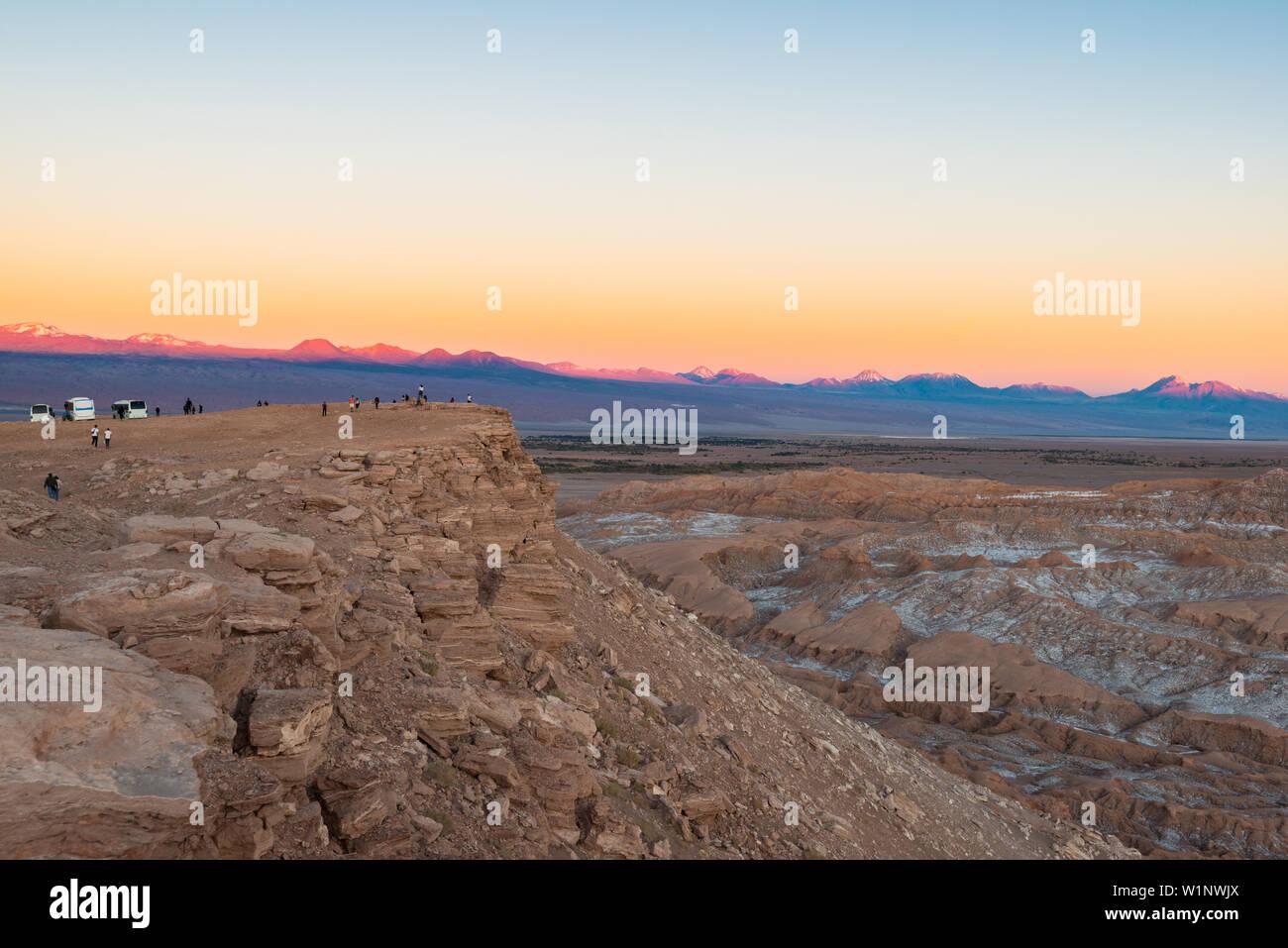 Tourist visiting the Moon Valley at the Salt Mountain Range, San Pedro de Atacama, Atacama Desert, Chile Stock Photo