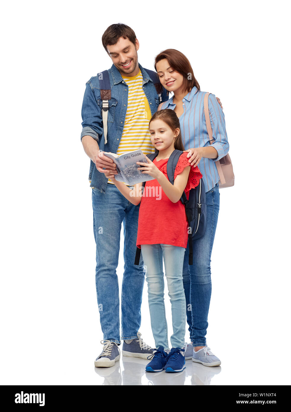 happy family with travel guide and backpacks - Stock Image