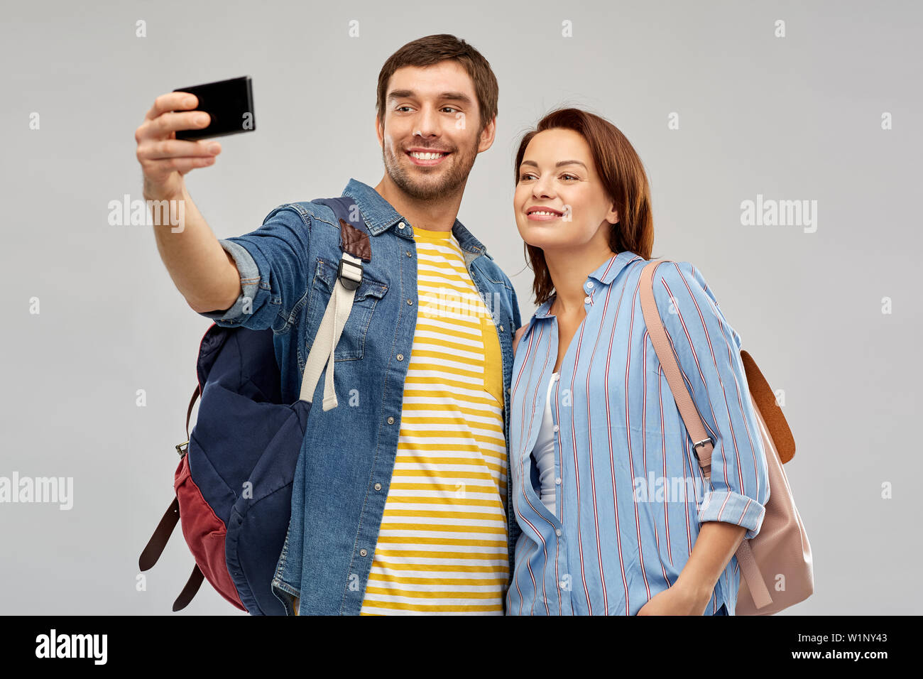 couple of tourists taking selfie by smartphone Stock Photo