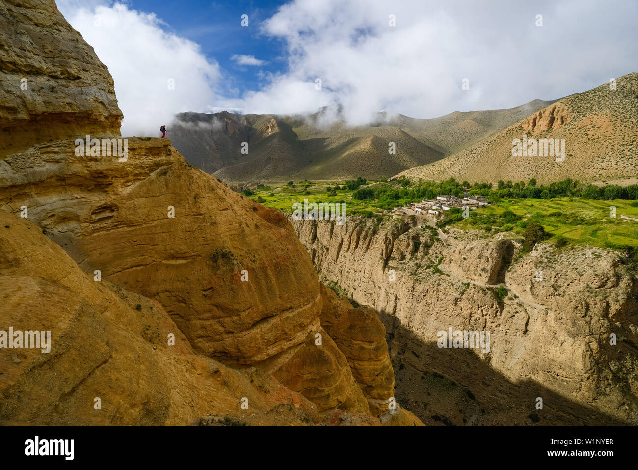 Young woman, hiker, trekker in the surreal landscape typical for Mustang in the high desert around the Kali Gandaki valley, the deepest valley in the Stock Photo