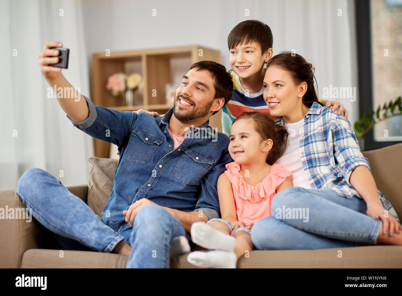 happy family taking selfie at home - Stock Image
