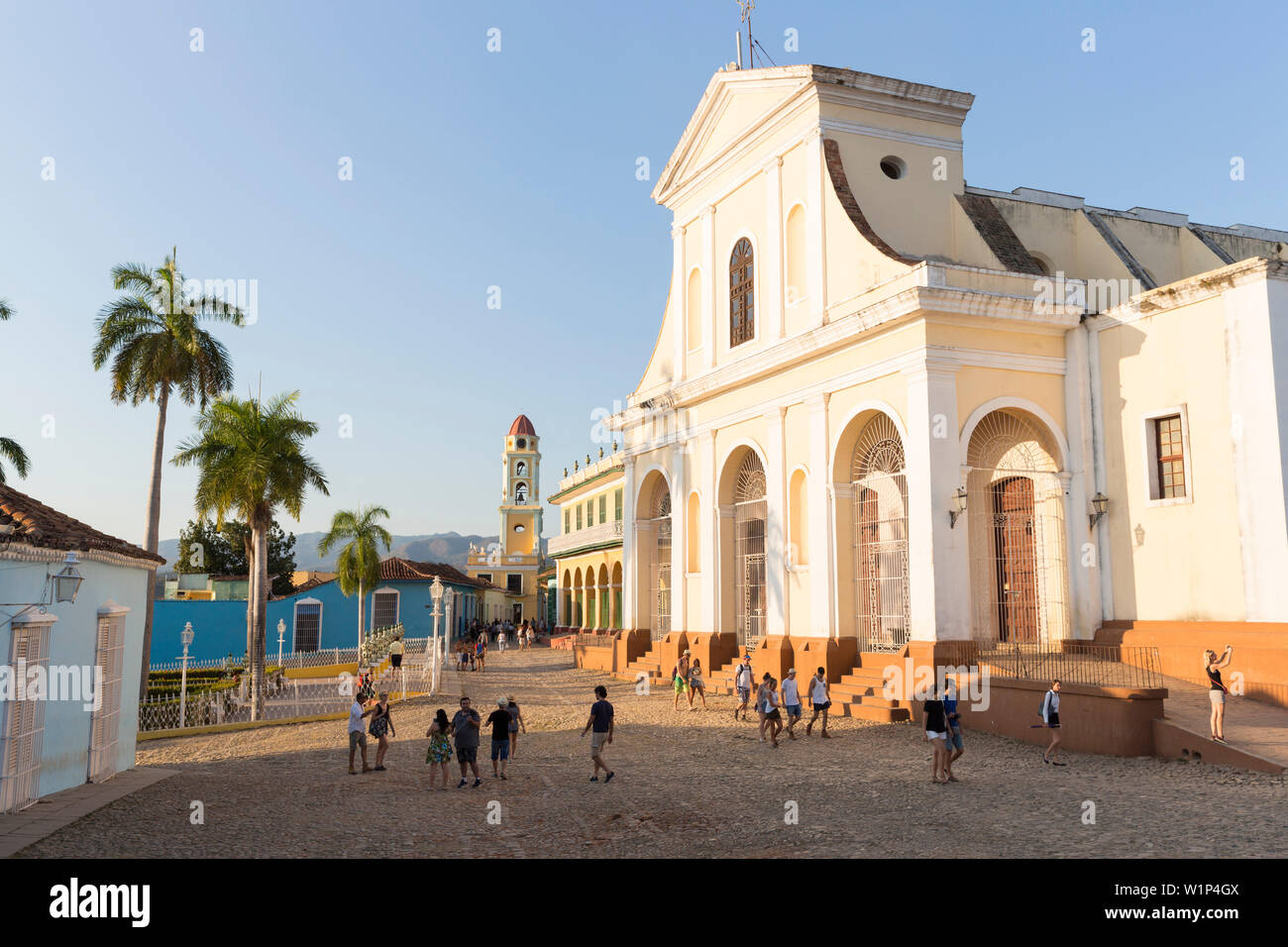Iglesia Parroquial de la Santisima Trinidad at Plaza Mayor in the background the bell tower of Museo Nacional de la Lucha, formerly Iglesia y Convento - Stock Image