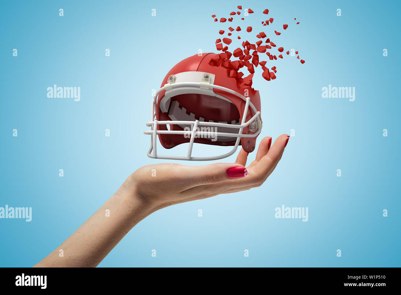 Closeup of woman's hand holding sports helmet which is breaking into small pieces that are flying away on light blue background. - Stock Image