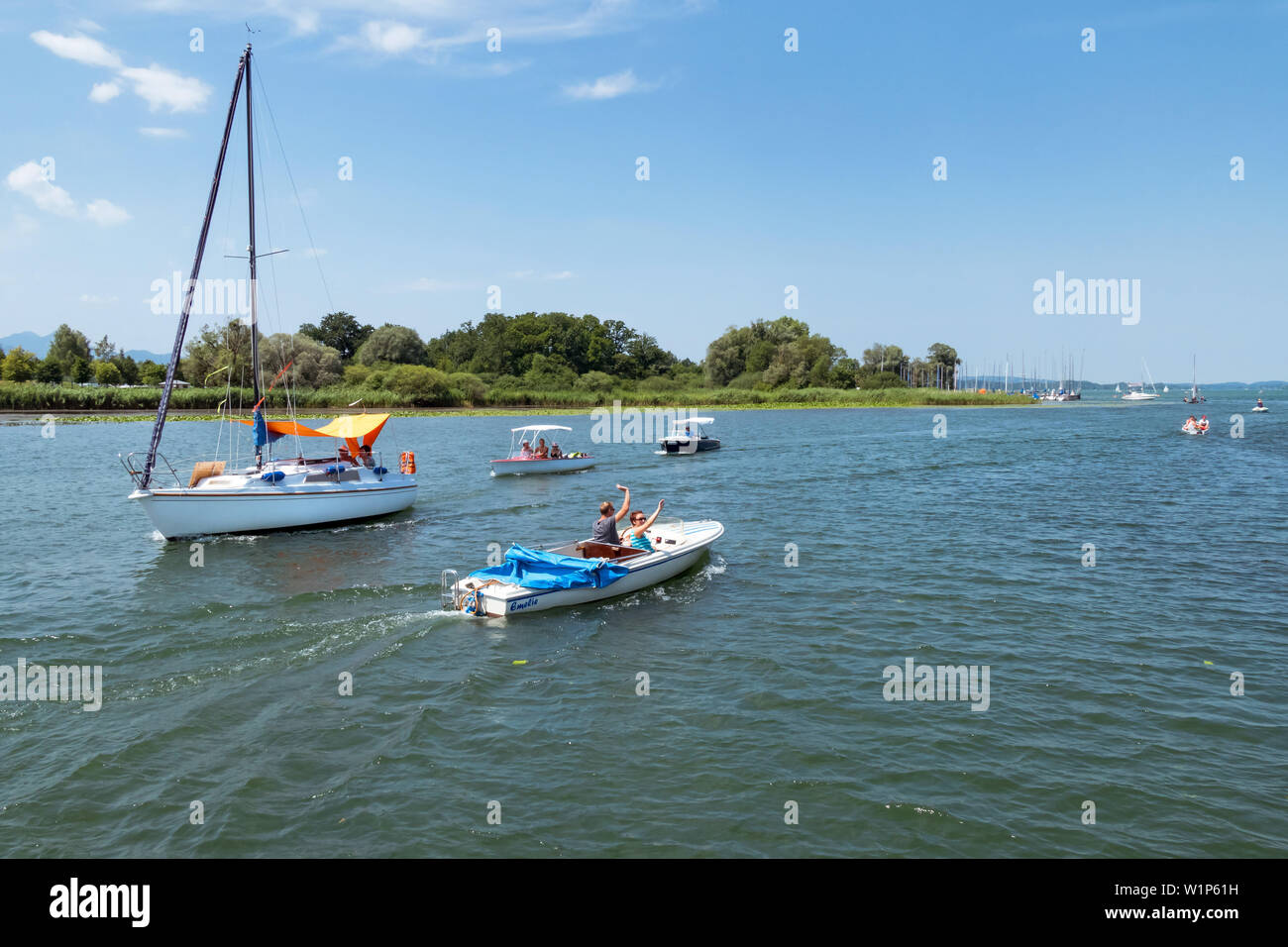Sailing and electric boats on the Chiemsee in field Stock Photo