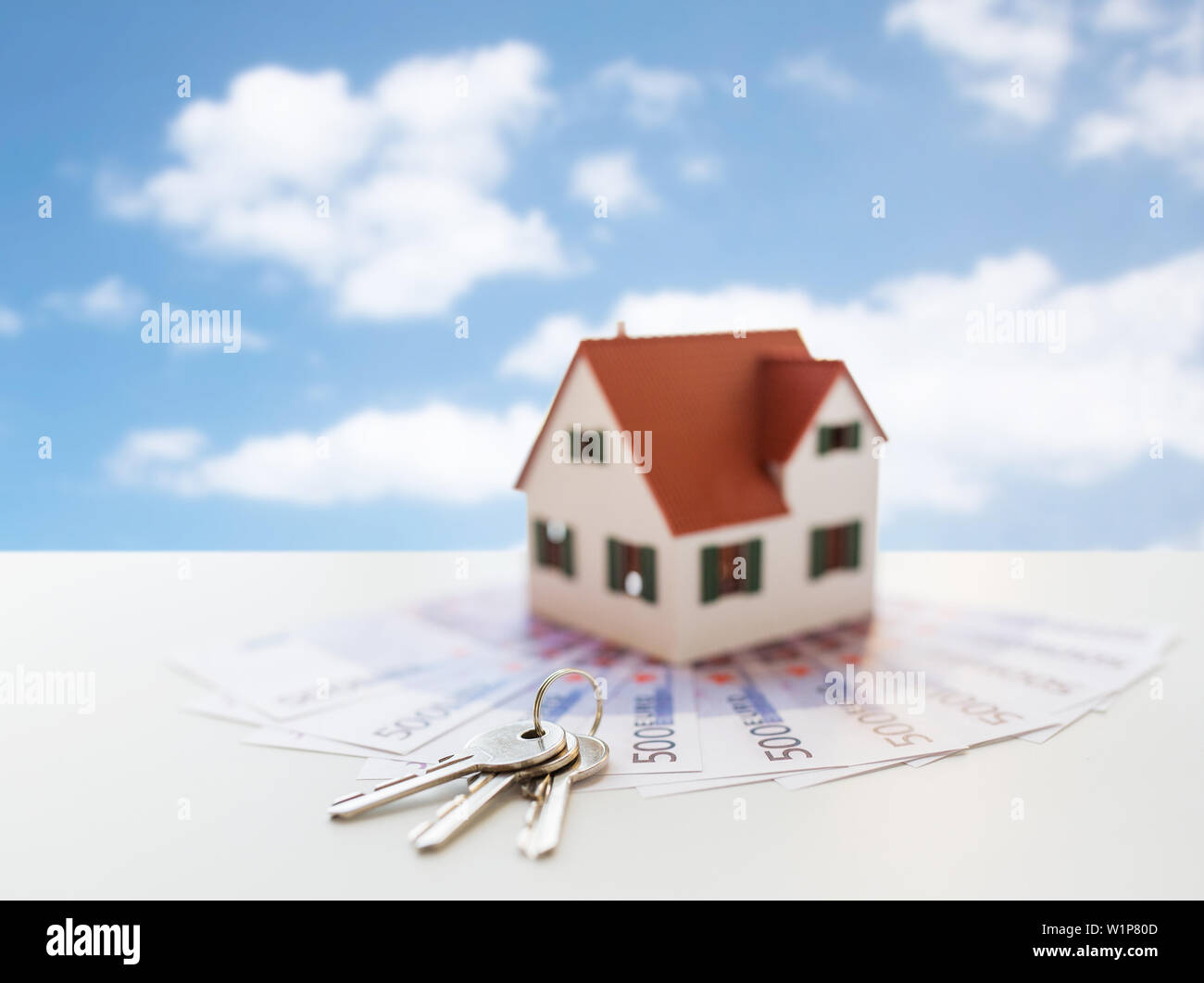 close up of home model, money and house keys - Stock Image