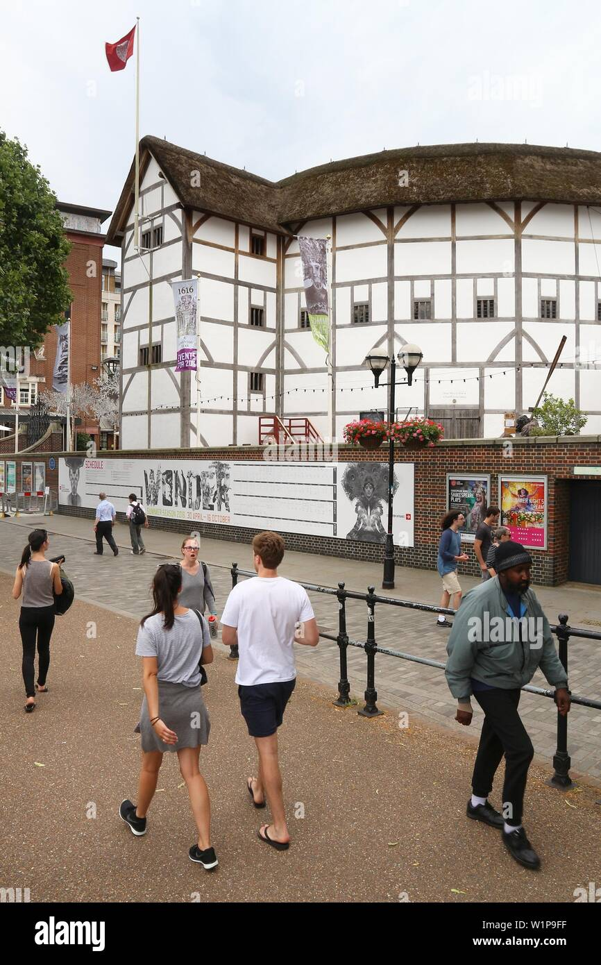LONDON, UK - JULY 8, 2016: People visit The Globe theatre in London, UK. London is the most populous city in the UK with 13 million people living in i - Stock Image