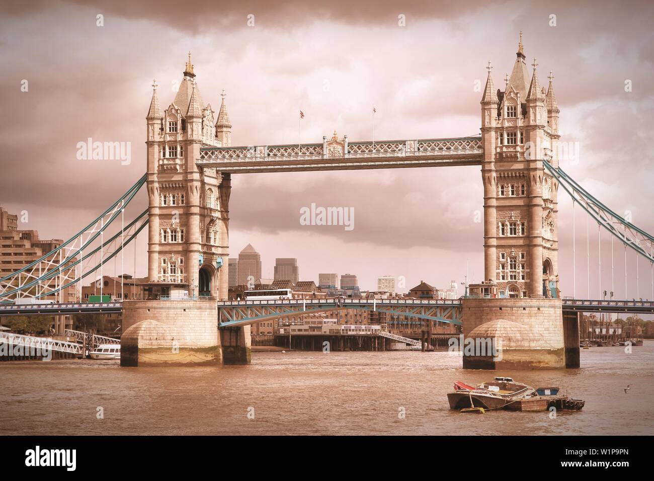 London, UK - Tower Bridge. Old landmark. Cross processed vintage photo filtered tone. - Stock Image