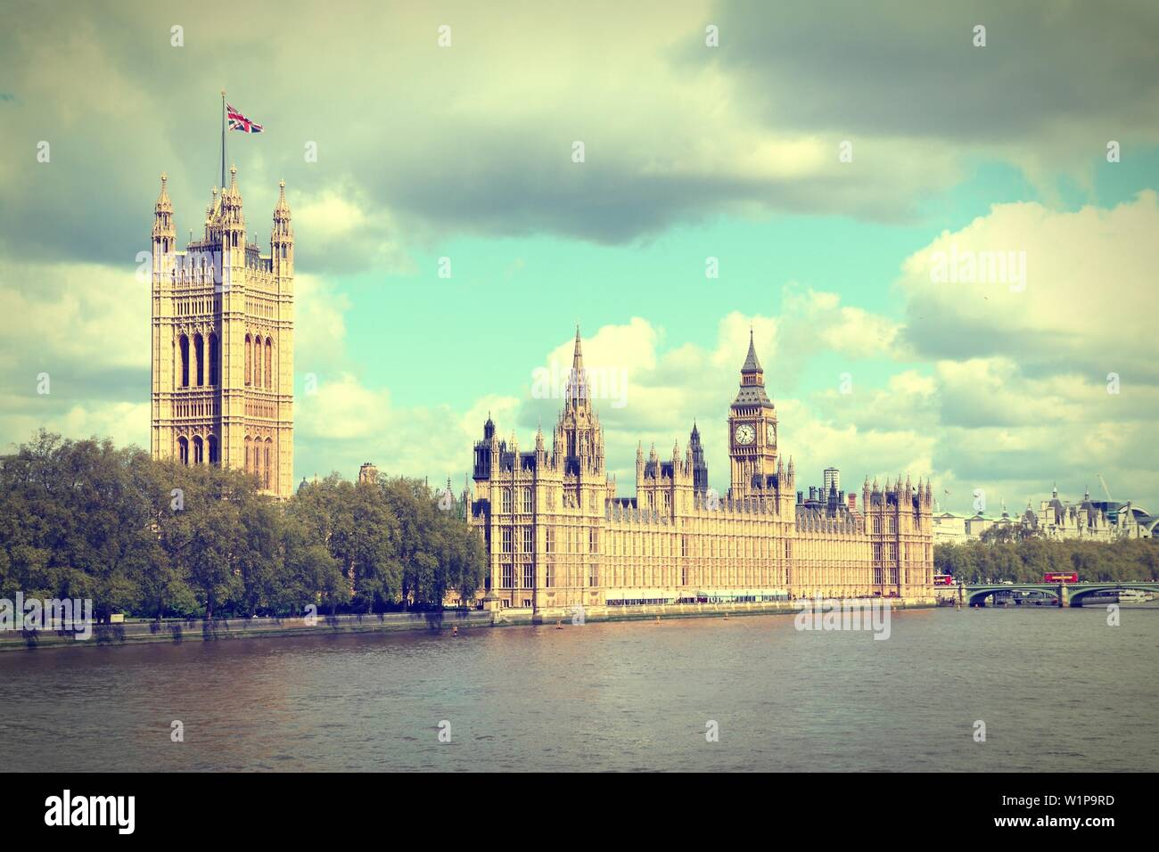 London, United Kingdom - Palace of Westminster (Houses of Parliament) with Big Ben clock tower. UNESCO World Heritage Site. Cross processed vintage ph - Stock Image