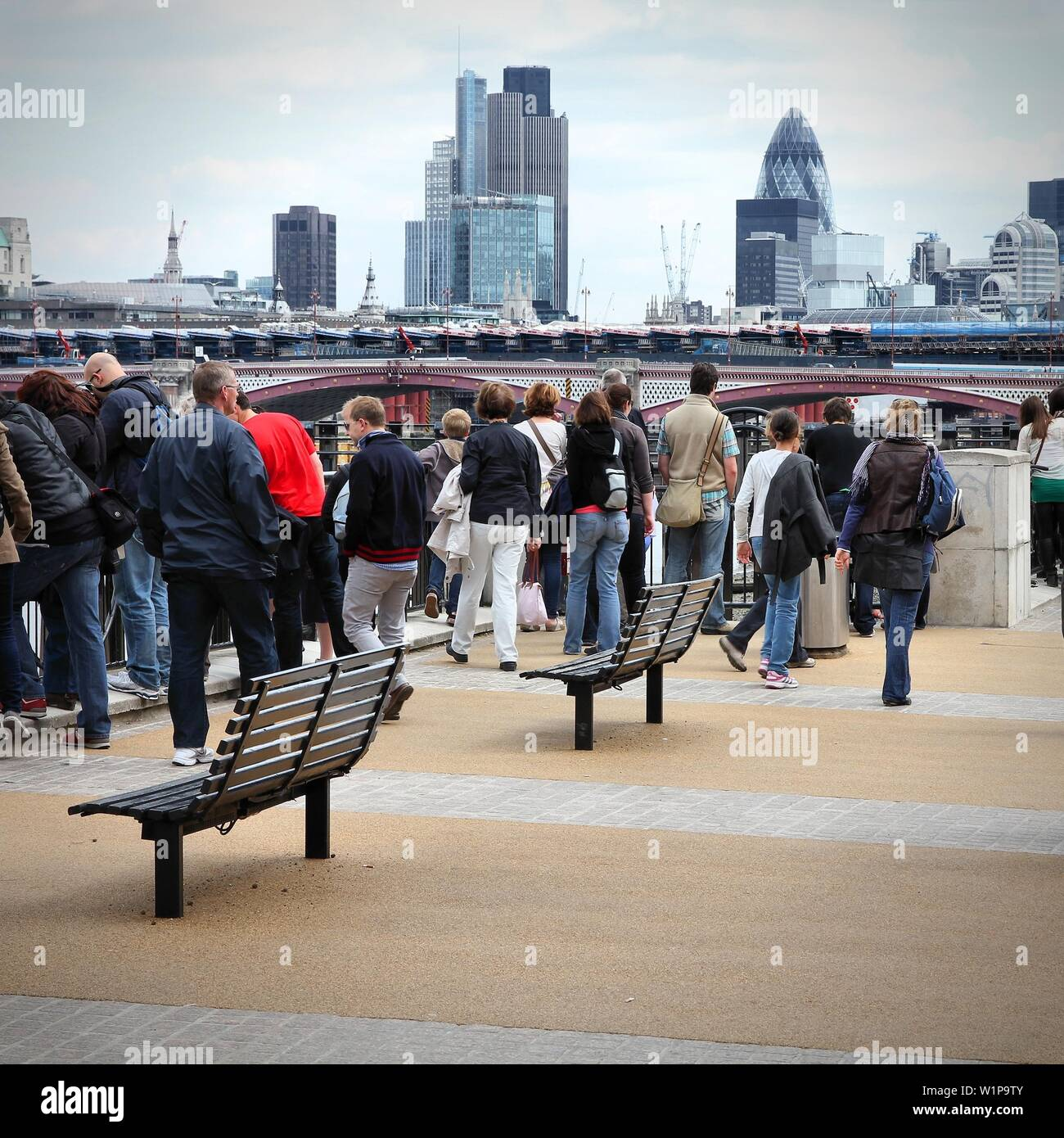 LONDON, UK - MAY 13, 2012: Tourists visit Thames Embankment in London. With more than 14 million international arrivals in 2009, London is the most vi - Stock Image