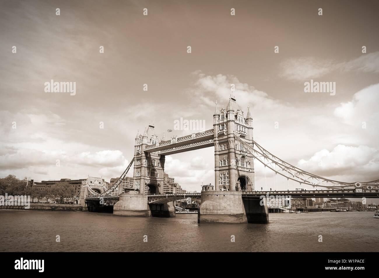 London, United Kingdom - famous Tower Bridge. Old landmark. Sepia tone - filtered retro style monochrome photo. - Stock Image