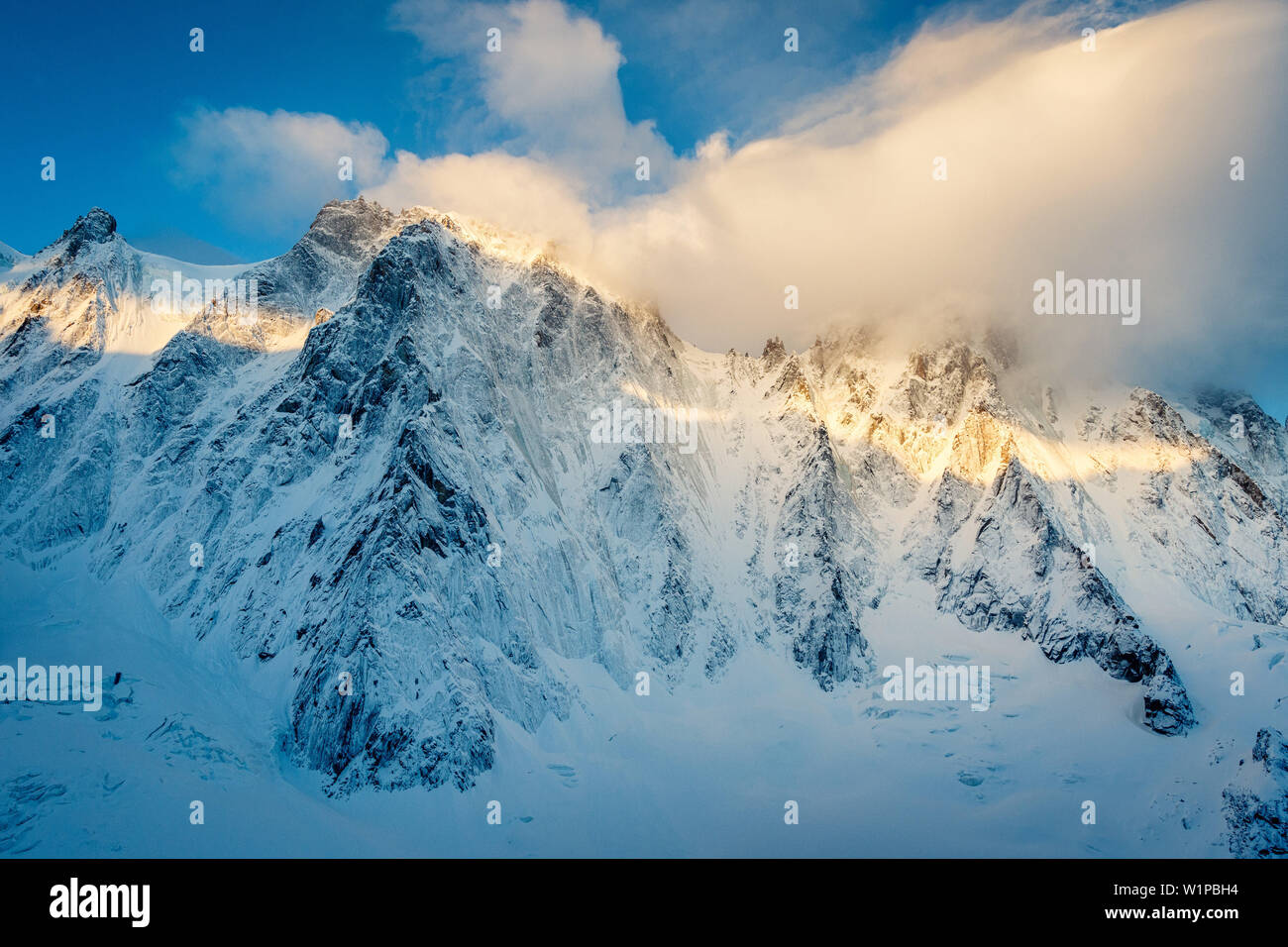 Aiguille Verte during the first light of the day, fresh snow, Chamonix, Haute-Savoie, France - Stock Image