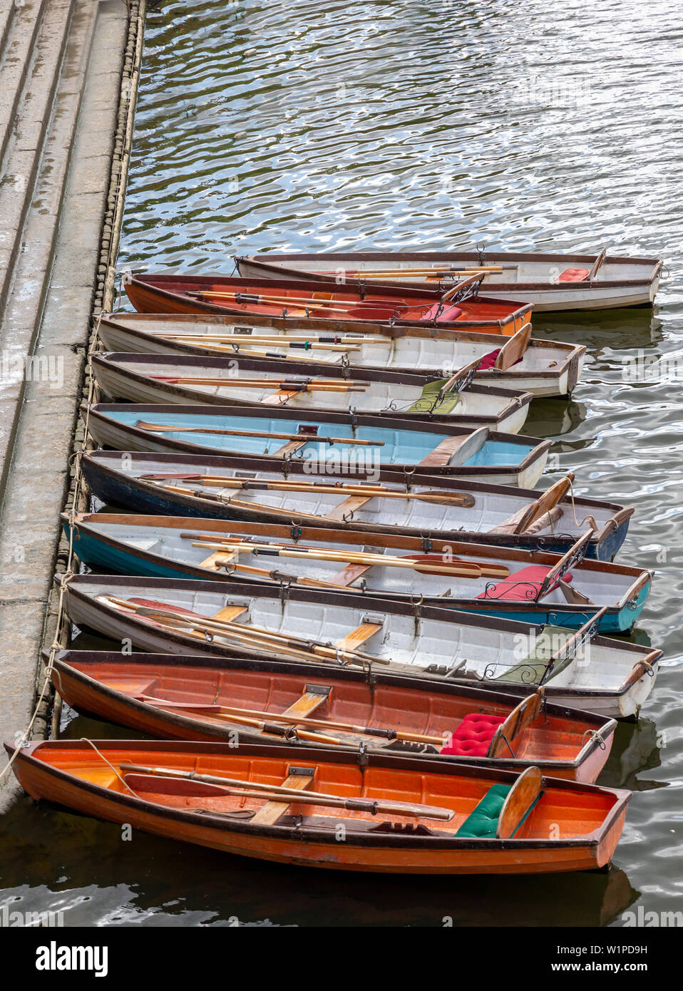 Wooden boats for hire moored on the River Thames, UK - Stock Image