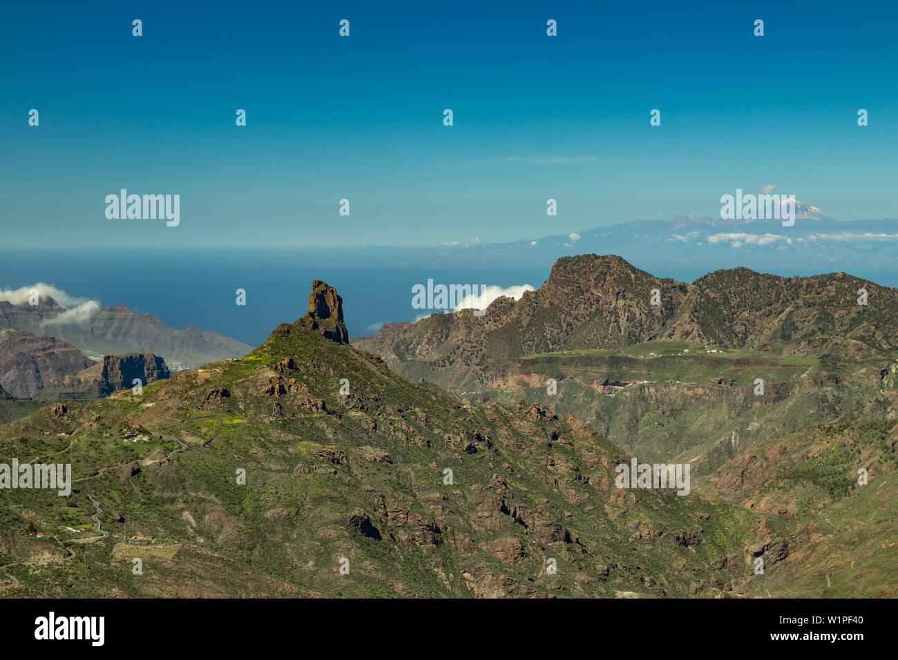 Center of Gran Canaria. Spectacular aerial view across Caldera de Tejeda towards Teide on Tenerife. Famous Roque Bentayga on average and Tenerife abov Stock Photo