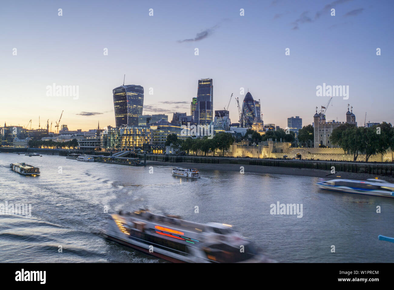 City of London, Financial district, office buildings in the City of London, River Thames at Twilight - Stock Image