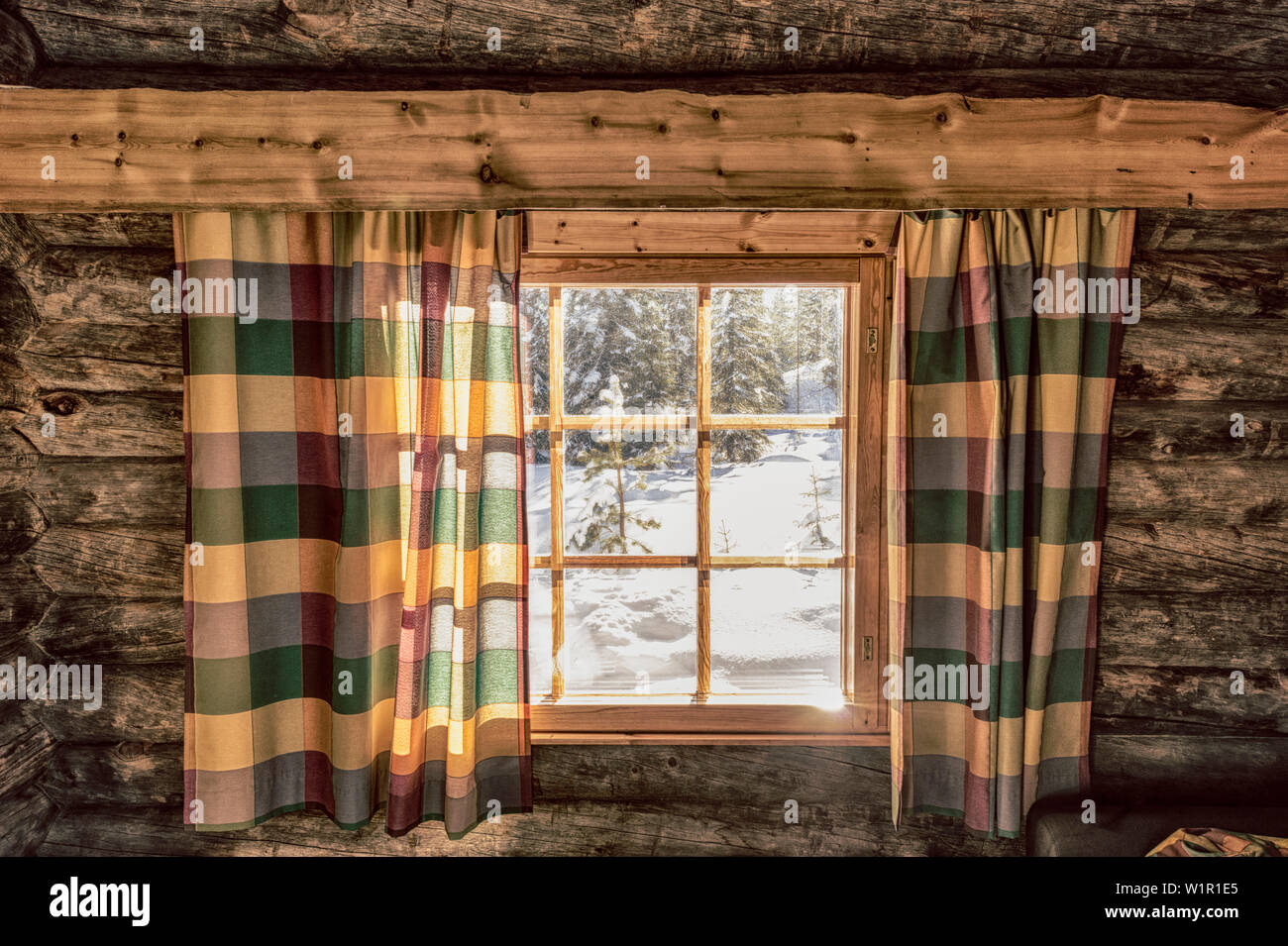 View Out Of The Window Of A Cosy Log Cabin Onto The Snowscape Luosto Finnish Lappland Stock Photo Alamy