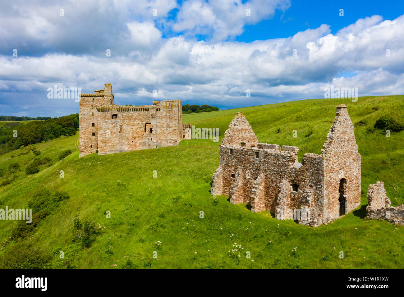 Elevated view of 14th century Crichton Castle and stables in Midlothian, Scotland, UK - Stock Image