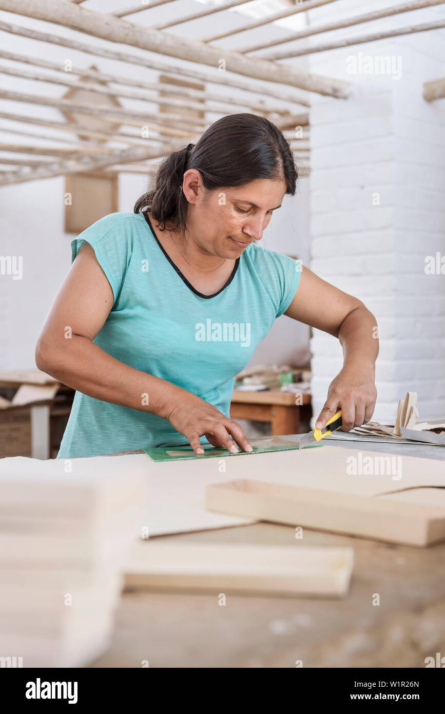 workers producing diverse things with their fine art paper, historical Paper Production at Fundación San Lorenzo, Barichara, Departmento Santander, Co - Stock Image