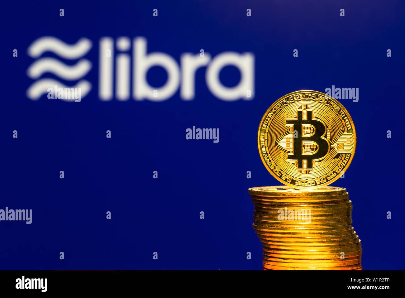 Gold Bitcoin Coins with the Facebook Libra Crypto Coin logo on