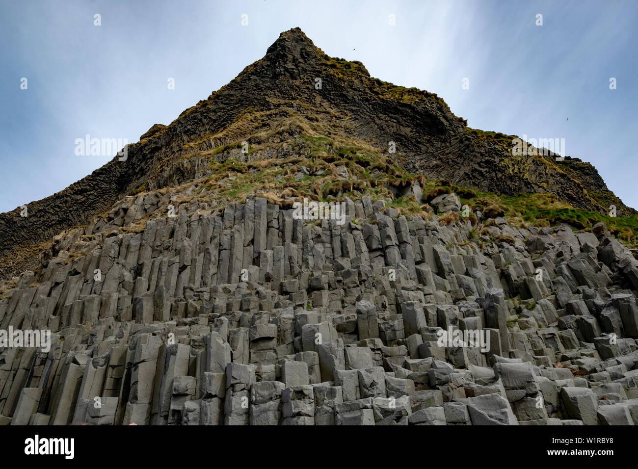 Unusual rock formations on the black sand beach of Reynisfjara, Iceland - Stock Image