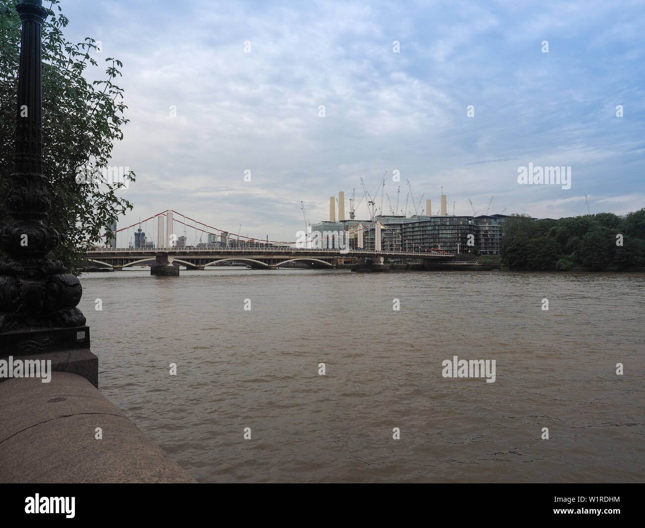 LONDON, UK - CIRCA JUNE 2019: Panoramic view of River Thames with Battersea Power Station and Chelsea Bridge - Stock Image