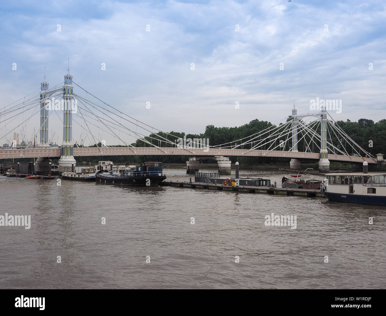 LONDON, UK - CIRCA JUNE 2019: Panoramic view of River Thames in Chelsea with Albert Bridge - Stock Image