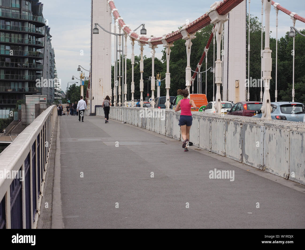 LONDON, UK - CIRCA JUNE 2019: Chelsey Bridge crossing River Thames - Stock Image