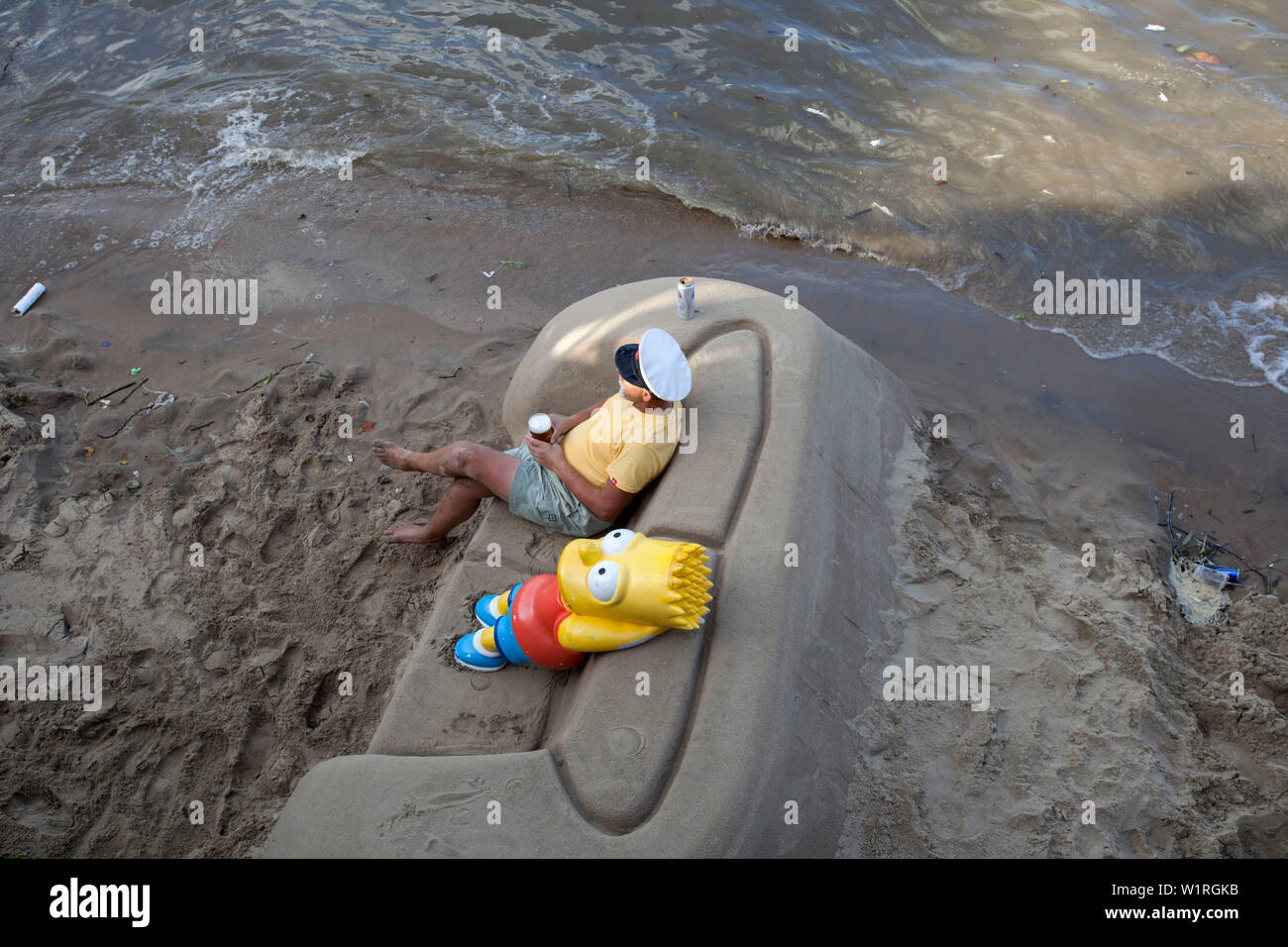 Bart Simpson model relaxing on sand sofa, southbank London - Stock Image