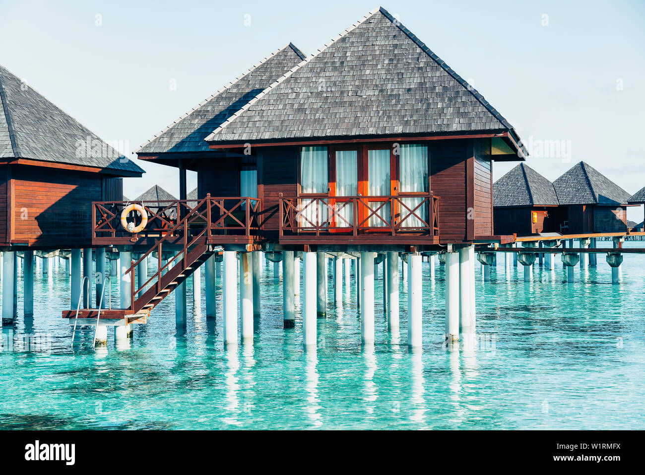 Water Villas In Maldives In A Sunny Day Island Paradise