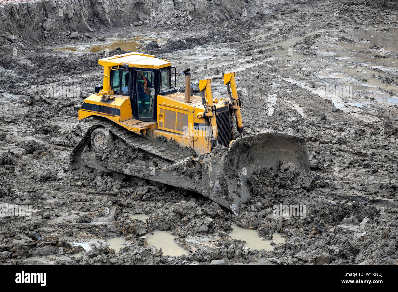 Push dirt with a dozer. Bulldozer working working at construction site. - Stock Image