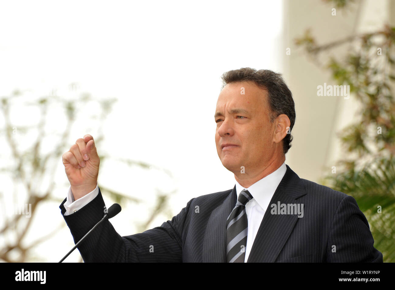 LOS ANGELES, CA. April 14, 2009: Tom Hanks at Hollywood Walk of Fame star ceremony honoring the late George Harrison. The star was placed outside the famous Capital Records building in Hollywood. © 2009 Paul Smith / Featureflash - Stock Image
