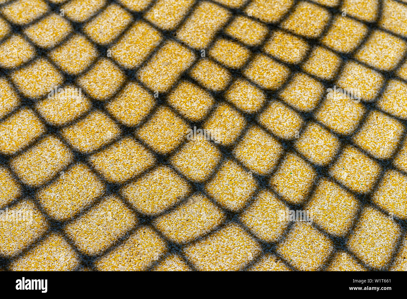 grid shadow on the sand. Background and texture - Stock Image