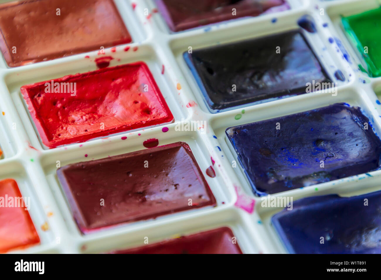 Creative artistic education concept - the box with the set of colorful watercolor paint close up Stock Photo
