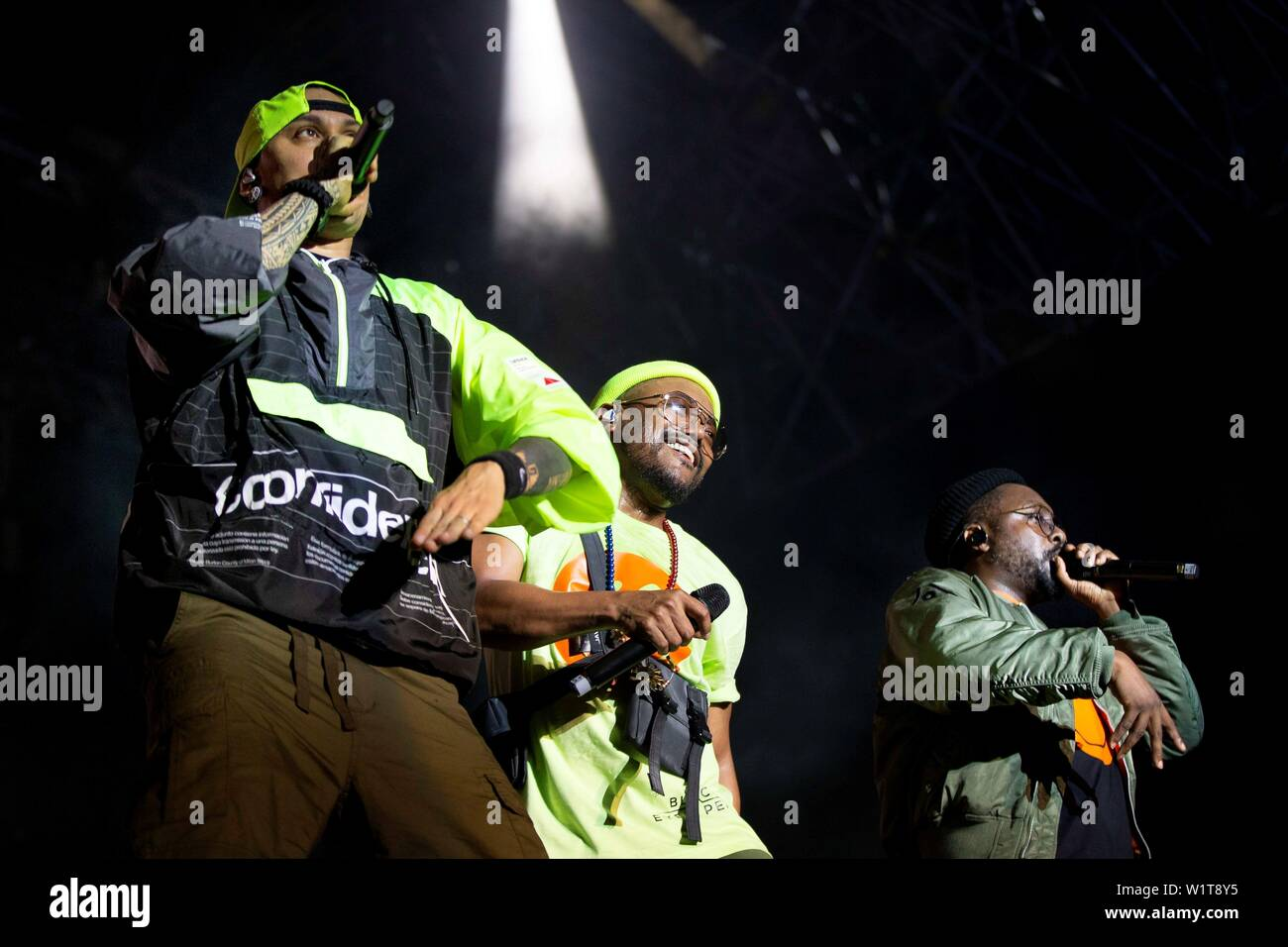 Barcelona, Spain. 3rd July 2019. Members of US hip hop band The Black Eyed Peas Taboo (L), Apl.de.ap (C) and Will.i.am (R) perform on stage during the band's concert at the Cruilla Music Festival in Barcelona, Spain, 03 July 2019. EFE/ Enric Fontcuberta Credit: EFE News Agency/Alamy Live News Stock Photo