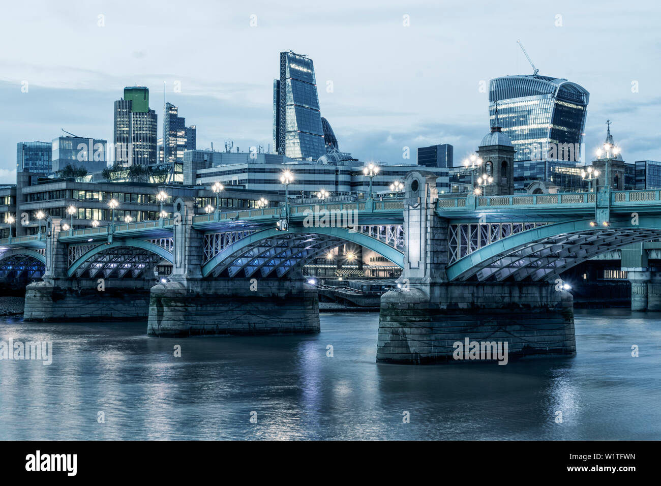 River Thames, Modern Architecture in Financial District in City of London, The Goerkin , Tower 42, Leadenhall Building, Southwark Bridge, UK - Stock Image