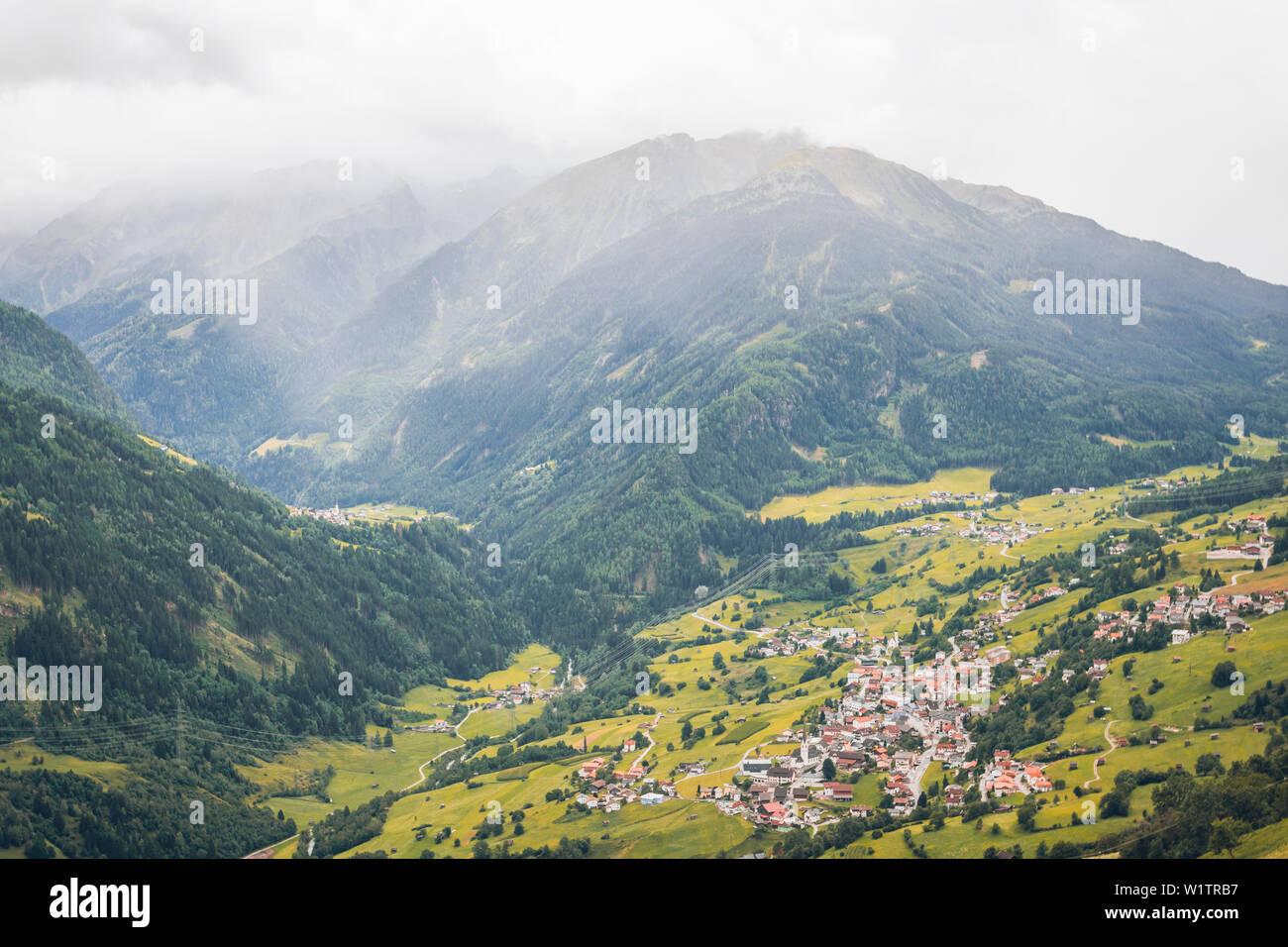 Panoramic view over a mountain village, E5, Alpenüberquerung, 4th stage, Skihütte Zams,Pitztal,Lacheralm, Wenns, Gletscherstube, Zams to Braunschweige - Stock Image