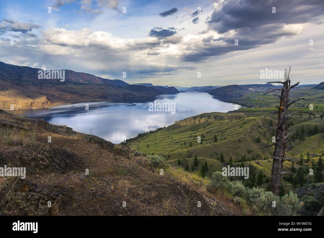 Sweeping Kamloops Lake Viewpoint on Trans-Canada Highway and Dramatic Sky Landscape, Interior of British Columbia, Canada Stock Photo