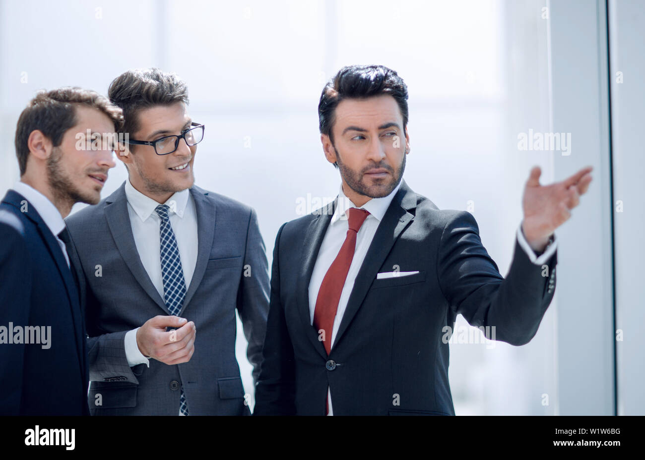 business partners discussing a joint project - Stock Image