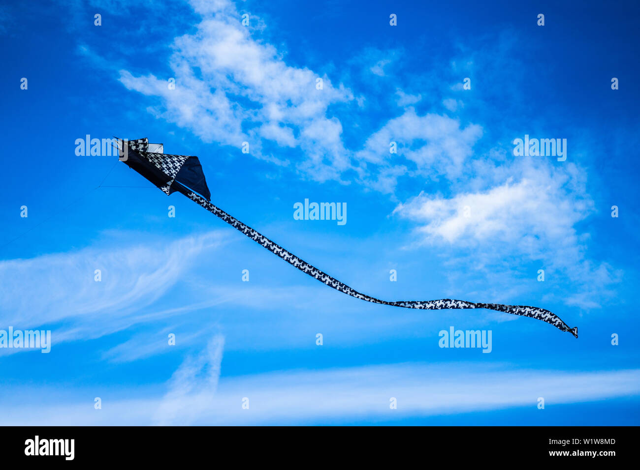 Bedford,Bedfordshire,UK,June 2,2019. Kites flying in the sky among the clouds.Bedford International Kite Festival. Stock Photo