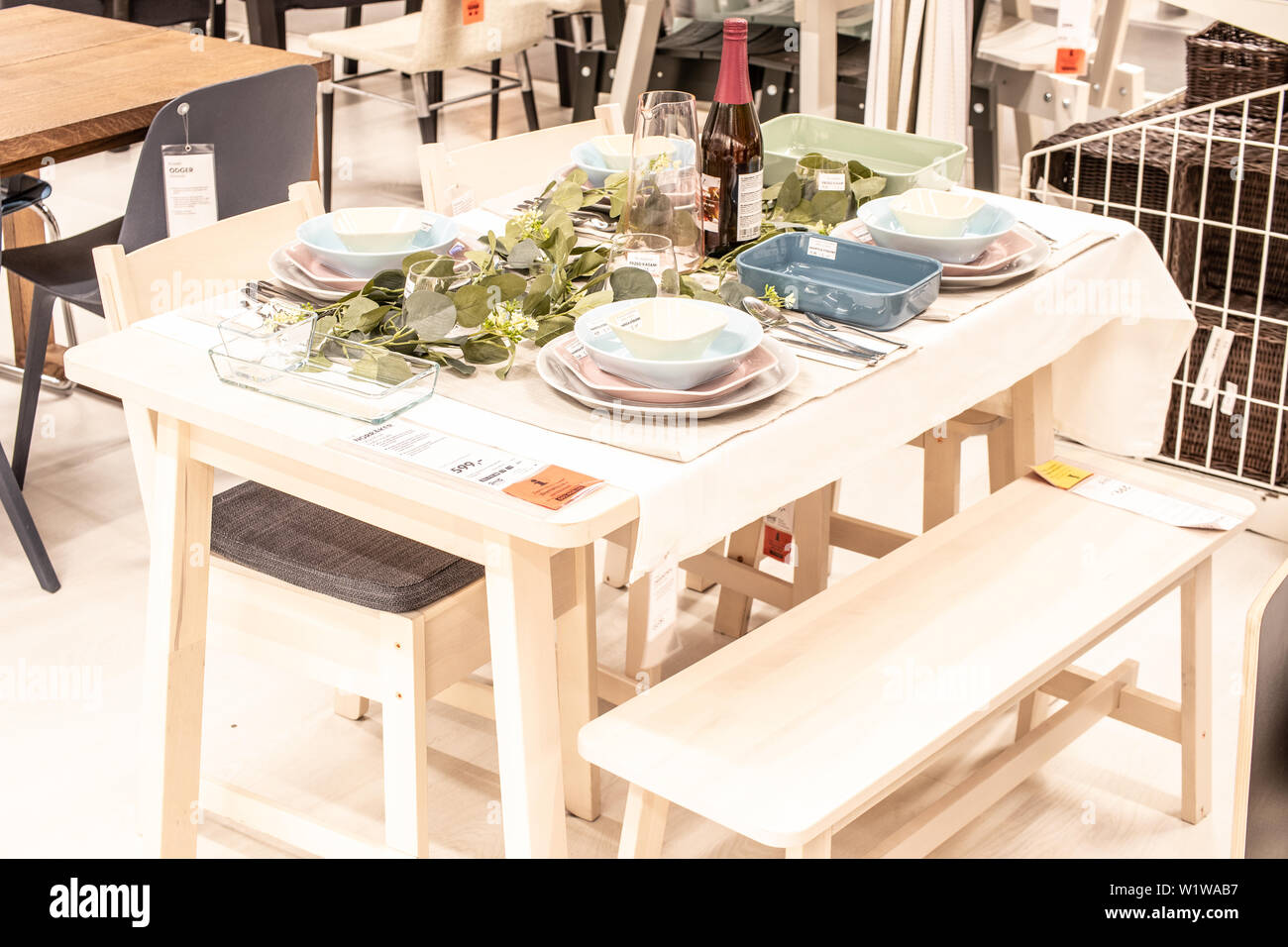 lodz poland jan 2019 exhibition interior ikea store modern dining table chairs tableware ikea sells ready to assemble furniture home accessories image