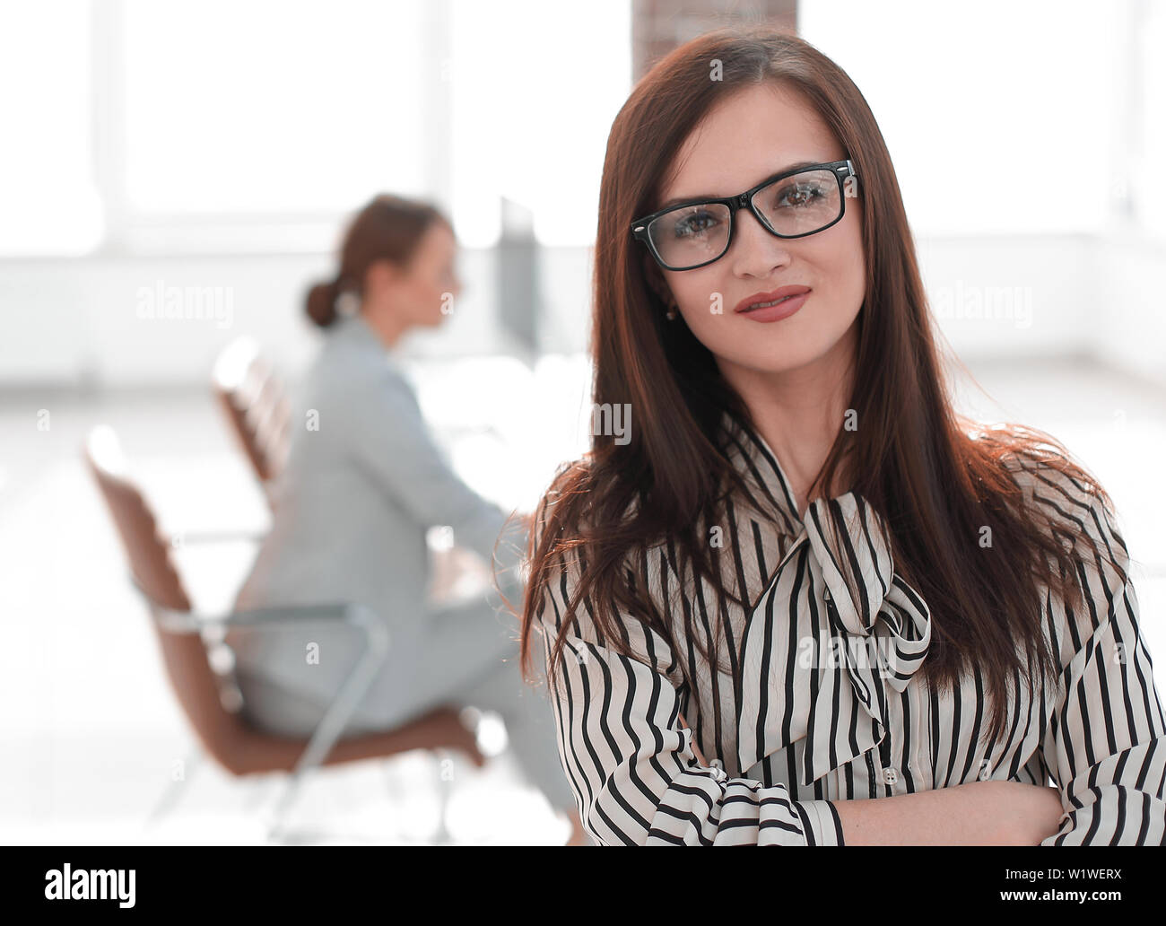 successful business woman on blurred office background - Stock Image