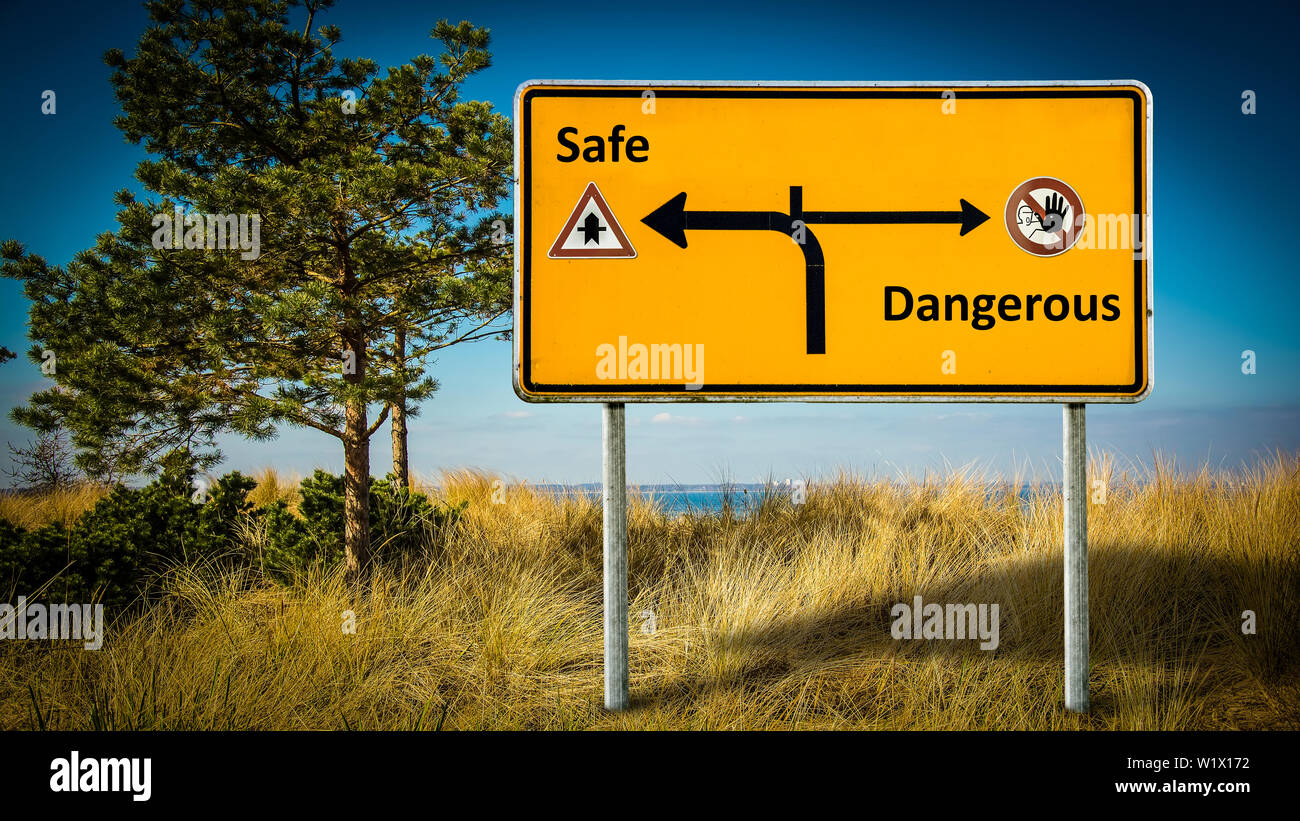 Street Sign the Direction Way to Safe versus Dangerous - Stock Image