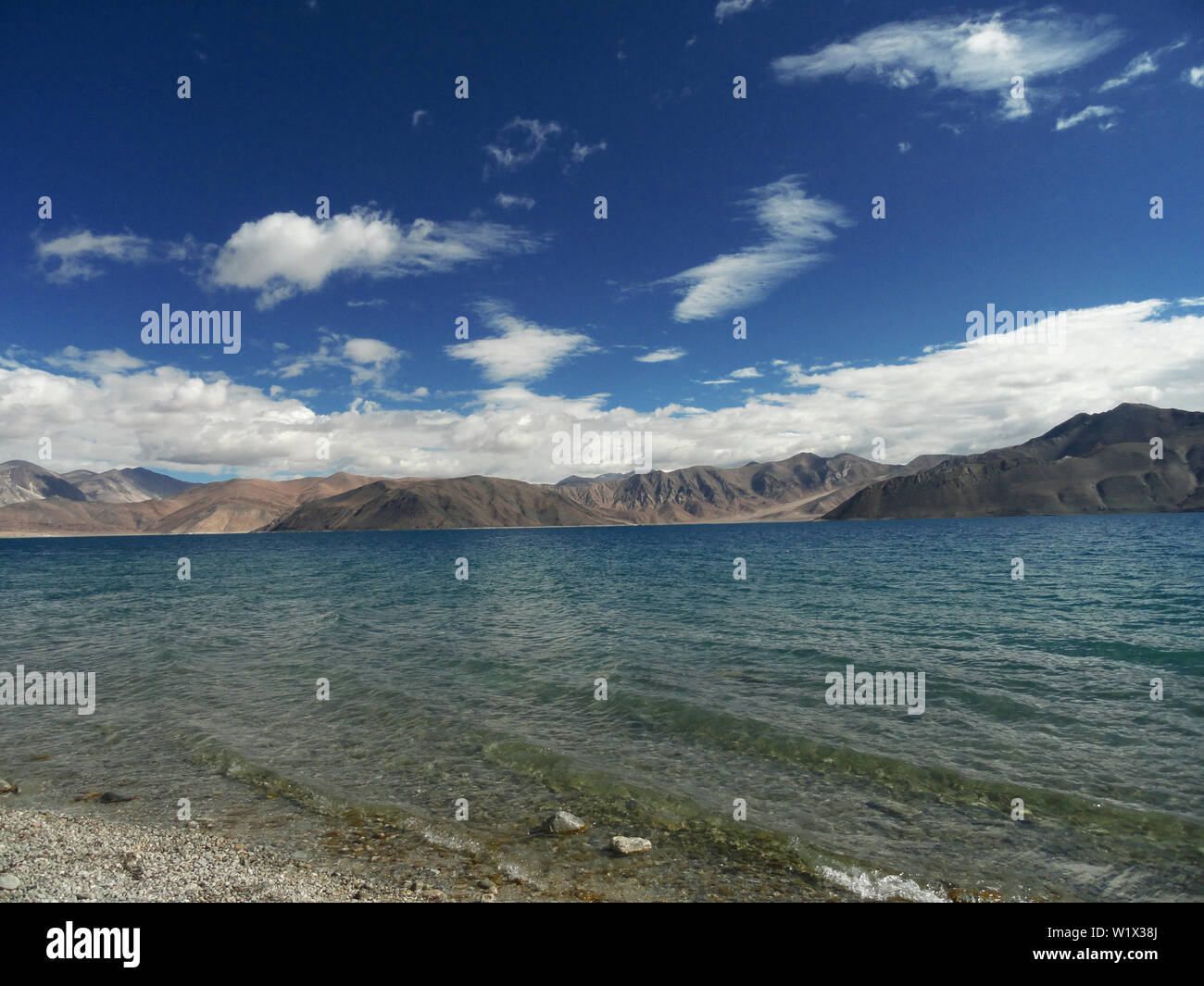 Lake in the sky: Pangong Lake, Ladakh india, in the early morning busking in the sunlight. - Stock Image